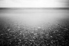 Live in symbiosis (zdenisaba) Tags: rocks shore horizont water sea sky monochrome symbiosis clouds live kos island shallow