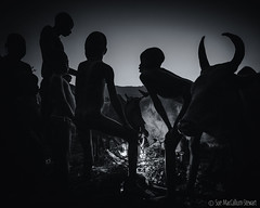 Warming up after a chilly night in the Omo Valley (Sue MacCallum-Stewart) Tags: africa ethiopia omovalley suri tribe family blackwhite