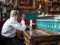 Turquoise Guinness (Magic Pea) Tags: streetphotography streetphoto street candid unposed urban london photo photography magicpea oldqueenshead essexroad islington man pint sitting pub