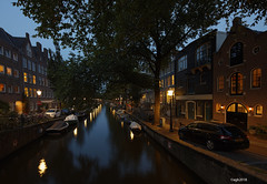 Amsterdam. (alamsterdam) Tags: amsterdam canal evening longexposure cars bikes reflection