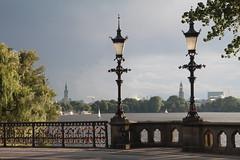 Schwanenwik (Elbmaedchen) Tags: schwanenwikbrücke schwanenwik alster hamburg michel rathaus segeln ausenalster kandelaber silhouette liebesschlösser