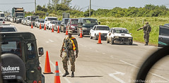 Roadblock in Jamaica (Performance Impressions LLC) Tags: roadblock militarycheckpoint checkpoint police marshalllaw stateofemergency cars soldiers montegobay saintjames tropical jamaica caribbean travel vacation tourism island coast ocean crime crackdown violence safety security jm