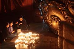 Devotional (peterkelly) Tags: digital gadventures transmongolianadventure asia canon 6d mongolia ulaanbaatar gandanmonastery migjidjanraisigstatue family mother children golden gold fire flames candles worship devotion buddhism buddhist