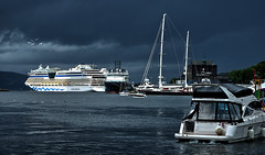 The Aida leaves harbour before the weather's getting rough (Fr@nk ) Tags: countingbirds ef24105mmisl rec0309 blog norway sonya7r mirrorless travel water weather adult swimming boat ship aida cruise fjord mountains lake pond yacht frnk mrtungten62 clouds sky himmel ciel nuages ddtag5 europ12