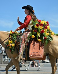 Brianna (Scott 97006) Tags: rider riding woman female lady roses parade horse beauty equestrian wave smile