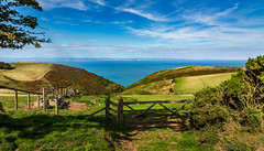A lovely field for grazing livestock. (Ian Emerson (Thanks for all the comments and faves) Tags: coast countryside coastline somerset sea seascape field gate clouds southwestcoastpath england farmland