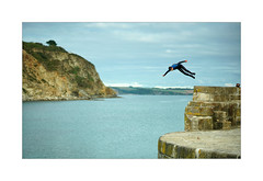 COMING IN TO LAND (Barry Haines) Tags: back flip backflip charlestown cornwall harbour diving boys gm 85mm f14 sony a7r2 a7rii sea sky rock landscape water grass lake bay