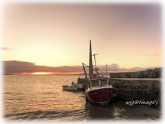 Early morning light, Moville, Co. Donegal. (willieguildea) Tags: harbour port wuay moville donegal ireland eire ulster boat fishingboat sunrise sea water waterscape ocean bay sky cloud nikon coolpix p900 river lough loughfoyle