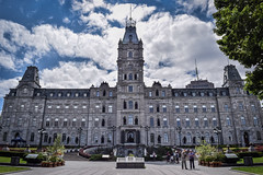 The Parliament Building (Hôtel du Parlement) of Québec (T.M.Peto) Tags: parliamentbuilding hôtelduparlement québeccity villedequébec québec quebeccity quebec historic historicsite historical history architecture edifice city urban cityscape cityphotography urbanphotography citylife citybuildings cityscapephotography buildings structures lookingup lookup landscape landscapephotography landscapes scenic scenery sceneryphotography outdoor outdoors outdoorphotography nikonoutdoors nikon nikond3300 nikonphotography adobelightroom lightroom outside wanderlust travel travelphotography sky clouds cloud building people canada tower