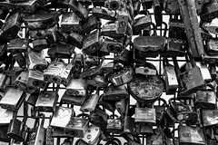 promises (Chilanga Cement) Tags: fuji fujix100f fujifilm bw blackandwhite monochrome helsinki finland bridge lock locks promises
