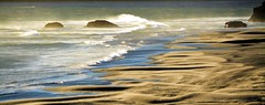 LIFE IS LIKE RIDING A WAVE.  TO KEEP YOUR BALANCE, YOU MUST KEEP MOVING.  ~Eric Carlson (Irene2727) Tags: seashore sea ocean waves sand sanddunes dunes nature rocks scenery pano panorama landscape scape oregon coast