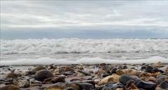 The Beach... (markwilkins64) Tags: uk christchurch solent ruleofthirds foam seafoam markwilkins clouds sky pebbles stones waves sea beach