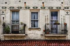 "left a note when morning came (listening to ""taro"", alt j) (haint_blue) Tags: canon louisiana neworleans nola crescentcity bigeasy building balcony brick plants windows windowwednesday"