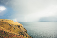 Raasay & Lealt Bay. (Matthieu Robinet) Tags: a72 alpha folk glen highlands landscape loch outdoor outlander roadtrip scotland somewhere sonya7ii travel uk wanderlust winter winterscape rainbow paradise cloudy winterday picoftheday photograph massive nature powerful storm coming division duality cliffs raasay island rocks blue yellow sun hiding secretplace magicmoment alone stormy mood delight imaginary dreamscape escape stayandwander sea ocean wide wilderness