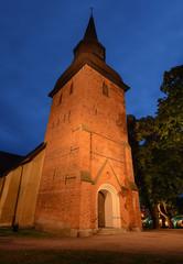 A Church at Dusk (henriksundholm.com) Tags: church architecture building tower steeple dusk forskyrka kyrka shadows park trees city urban clock door entrance steps hdr eskilstuna sverige sweden