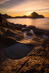 In Flux (Christopher Smith Creative) Tags: tranquil sunrise calm rockpools nationalpark gold mimosarocks nsw longexposure beach warm coastal sunstar still tidalpools rocks oceanpool goldenhour