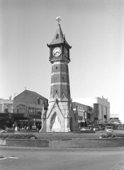 Telling the time for Skegness (DH73.) Tags: skegness lincolnshire clock tower trumpton minolta dynax 7000i 3570mm lens ilford fp4 125asa id11 11 11mins 68°f