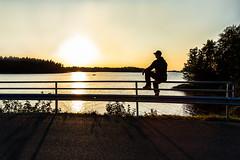 sitting on a railing (VisitLakeland) Tags: finland kuopio lakeland auringonlasku backlight dark evening ilta istua järvi kaide katsoa lake look luonto maisema nature outdoor road scenery sit sitting sunset tie