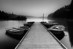 At Clear Lake, Oregon (Masako Metz) Tags: clearlake sisters oregon pacific northwest usa nature blackandwhite monochrome water boats hazy longexposure