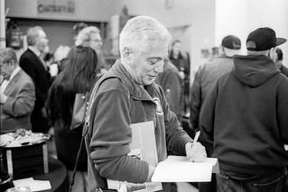 Jim Burger signing books at his photo show at MICA, October, 2017