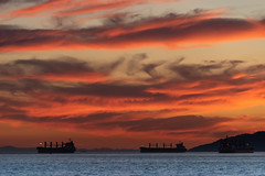 Ships and Sunset (armct) Tags: sunset horizon skyline clouds ships silhouette coastline harbour harbor sea bay water nightlights sky red yellow blue nightfall vancouver englishbay british columbia canada reflection d810 nikon nikkor 28300mm