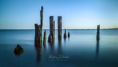 The Old Pier, Langstone Harbour, U.K. (Andrew J Hulson) Tags: pier groynes hampshire haylingisland harbour reflectionsinthewater wooden chichesterharbour portsmouth silkywater blue nikond810 longexposure stillness decay wrotten rotten sea seascapes landscapes langstoneharbour langstone