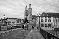Munsterbrücke, Zurich (Anthony Kernich Photo) Tags: zurich switzerland swiss city street urban town cityscape streetscape europe grossmunster munsterbrucke bridge view sunset monochrome blackandwhite olympus microfourthirds lumix highcontrast dusk twilight grayscale bw road church building architecture flickrheroes