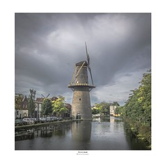 Scraping the Dutch skies (zoomleeuwtje) Tags: schiedam molen de vrijheid nederland netherlands rijnmond mill windmil