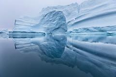 the iceberg city (yan08865) Tags: iceberg mountain zodiak sky landscape sea ocean arctic glacier ice seascape rock snow bay cruise water greenland scoresbysund fjord pavlis traveler solo icebergs