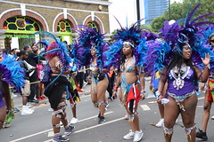 DSC_8390 Notting Hill Caribbean Carnival London Exotic Colourful Blue and Purple Costume with Ostrich Feather Headdress Girls Dancing Showgirl Performers Aug 27 2018 Stunning Ladies (photographer695) Tags: notting hill caribbean carnival london exotic colourful costume girls dancing showgirl performers aug 27 2018 stunning ladies blue purple with ostrich feather headdress