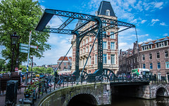 2018 - Amsterdam - Drawbridge - 1 of 2 (Ted's photos - For Me & You) Tags: 2018 amsterdam cropped nikon nikond750 nikonfx tedmcgrath tedsphotos vignetting bridge drawbridge dutchdrawbridge bikes bicycles canal arches railing