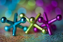 Multicolored Jacks - HMM (MarleenHuber) Tags: macro multicolor macromondays bokeh colorful toys shiny bright circles shapes