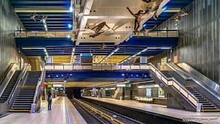 Brussels, Belgium: Comte de Flandre / Graaf van Vlaanderen metro station (Lines 1 & 5); Artist Paul van Hoeydonck employs 16 bronze mannequins suspended from the station ceiling