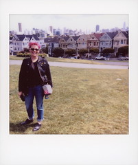 Tattooed Lady & The Painted Ladies (tobysx70) Tags: fujifilm fuji instax share sp3 square instant film smartphone ipad mini wifi printer tattooed lady and the painted ladies alamo park steiner street san francisco california ca portrait woman pink hair don't care tourist victorian houses cityscape skyscraper skyline grass full house tv movie location polawalk polavacation 042718 toby hancock photography