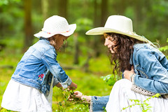 Family Ideas and Concepts. Tranquil and Positive Caucasian Couple of Mother and Little Daughter Having Time Together in Green Summer Forest. (DmitryMorgan) Tags: 2 35years 3035years activity adorable adult baby caucasian cheerful child childhood communication daughter denim enjoying forest forested fun garden girl green greenish hold jeans joy kid laugh life love mother outdoors parent park people recreation relationship smiling summer summertime sun talking teamwork tenderness thirties together togetherness two unity wife woman young