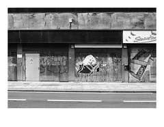 161105_00015_OM2n_city fragment 9/19 (A Is To B As B Is To C) Tags: aistobasbistoc b belgië belgium antwerpen antwerp antwerpencentraal pelikaanstraat olympus om2n analog film kodak tmax bw blackwhite blackandwhite monochrome street sidewalk city facade fragment samson urban urbanrenewal