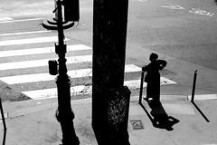 On the post (pascalcolin1) Tags: paris paris12 femme woman passagepiéton passage poteau post photoderue streetview urbanarte noiretblanc blackandwithe photopascalcolin 50mm canon50mm canon