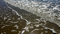 Froth on the beach (Marian Pollock) Tags: australia queensland portdouglas froth beach surf contrast water sand highights ocean design patterns pattern