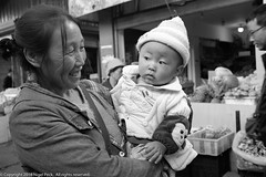 Proud Granny with Grandchild (Pexpix) Tags: female market blackandwhite woman baby lady ladies 攝影發燒友 stalls proud shops happy bw girl diqingzangzuzizhizhou yunnansheng china cn