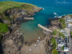 Port Isaac (Porthysek) (Ashley Wallace Photography) Tags: cornish northcoast creamtea flickr england uk unitedkingdom august summer aerialphotography drone dji aqua blue green cliffs boats waves sea sun cornwall village fishing harbour portisaac
