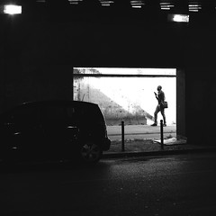Passing behind the opening (pascalcolin1) Tags: paris12 bercy homme man lumière light ombres shadows voiture car photoderue streetview urbanarte noiretblanc blackandwhite photopascalcolin 50mm canon50mm canon