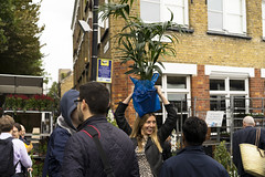 Plant pot on your head 2 (jamiethompson01) Tags: columbia road market flower people workers street sunflowers rain sun bethnal green vinyl vintage zeiss 55mm 18f 2018 uk london fun united kingdom east end plants buy sell bank holiday weekend sunday groups trip chilli peppers bulbs