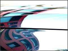 Karosserie (Barbara Wenzel-Winter) Tags: auto karosserie spiegelung abstrakt knackigbunt fassade häuser spiegelbilder