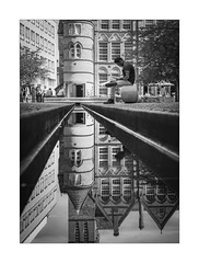 Reflecting (Dave Fieldhouse Photography) Tags: appicoftheweek birmingham brum city citycentre brindleyplace oozellssquare icongallery streetphotography street monochrome mono blackandwhite bnw people reflection reflections architecture gallery water buildings portrait fuji fujifilm fujixpro2 16mm stillwater still reading daytime wwwdavefieldhousephotographycom