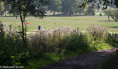 The Golf Course (M C Smith) Tags: pentax k3ii path forest grasses gold course flags greens green trees shadow man standing red nettles men playing white black