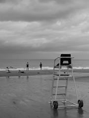 Llangrannog (Dubris) Tags: wales cymru ceredigion llangrannog seaside coast village monochrome bw sand beach chair lifeguard