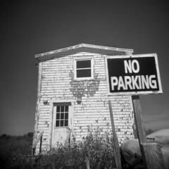 No Parking (LowerDarnley) Tags: holga pei princeedwardisland northrusticoharbour harbour maritimes atlanticcanada house shack harbor sign noparking