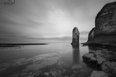 Flamborough Stack (AndyNeal) Tags: landscape seascape cliffs water sky beach blackandwhite monochrome longexposure neutraldensityfilter movement cloudmovement watermovement milkywater milkysea flamborough stack sea