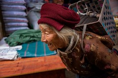 Street Candid, Kunming (Rod Waddington) Tags: china chinese yunnan kunming streetphotography street woman minority basket hat cap outdoor old older senior portrait people culture cultural candid