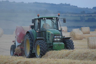 John Deere 7530 Tractor with a Lely Welger RP245 Round Baler
